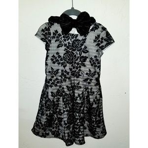 Girls festive dress with added in bow